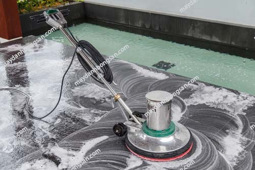 Thai people cleaning black granite floor with machine and chemical